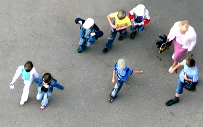 Children with adult in a school playground