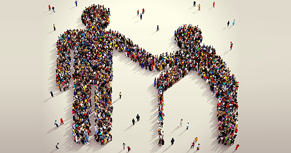 Large and diverse group of people seen from above gathered together in the shape of man helping elder