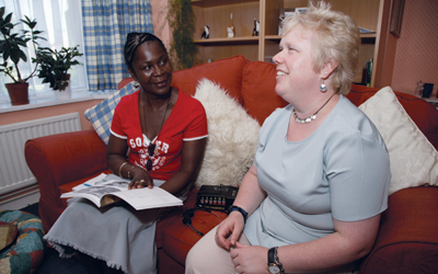 Social worker with a blind service user