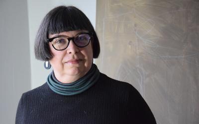 Headshot photograph of Dr Mimi Tatlow-Golden